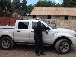 Pastor Fatton with his new truck for the orphanage.